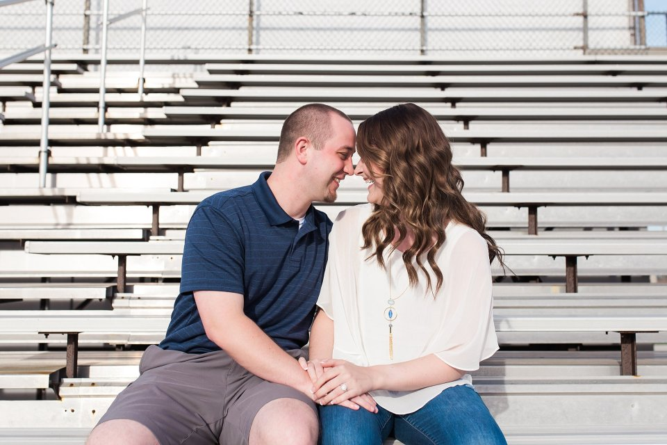 Engagement photos at football stadium