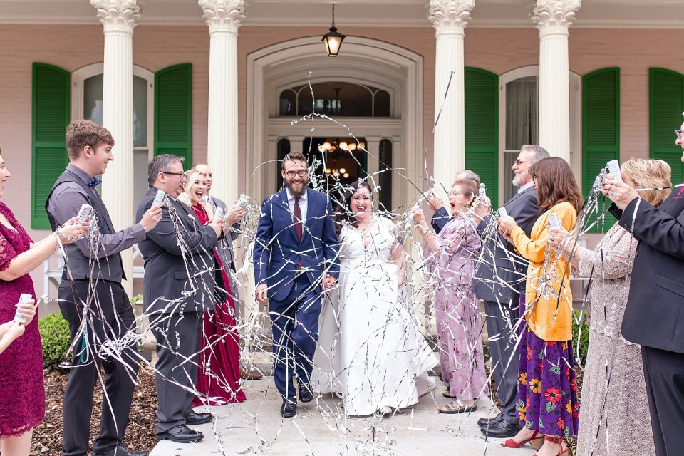 Bride and Groom exit with sparkler poppers at Edwards Place in Springfield wedding by Karen Shoufler