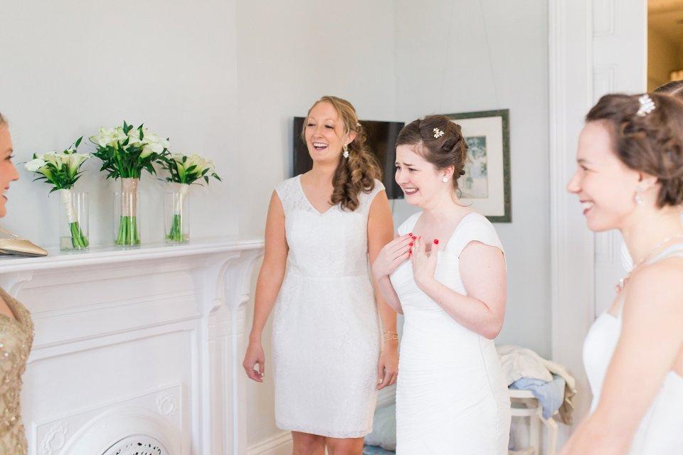 Bridesmaids reaction when seeing bride at shotgun house in Garden District New Orleans by Karen Shoufler