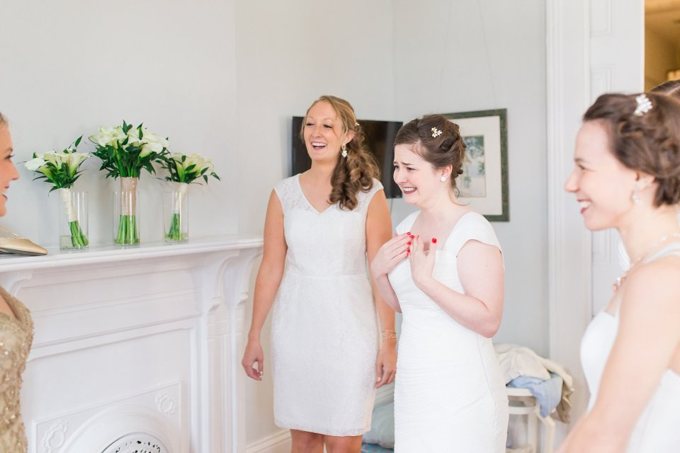 Bridesmaids reaction when seeing bride at shotgun house in Garden District New Orleans by Karen Shoufler