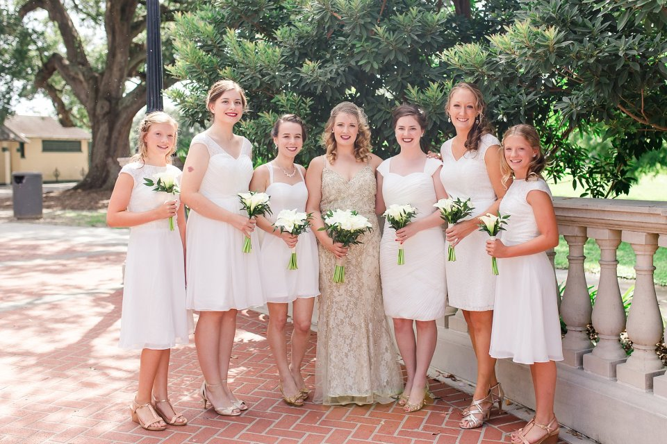Bride in BHLDN gown and Bridesmaids in white at Audubon Park by Travel Wedding Photographer Karen Shoufler