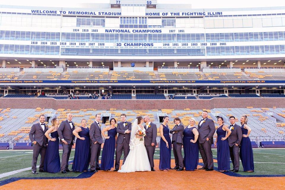 Orange and blue fall wedding at University of Illinois Champaign Urbana Memorial Stadium by Karen Shoufler Photography