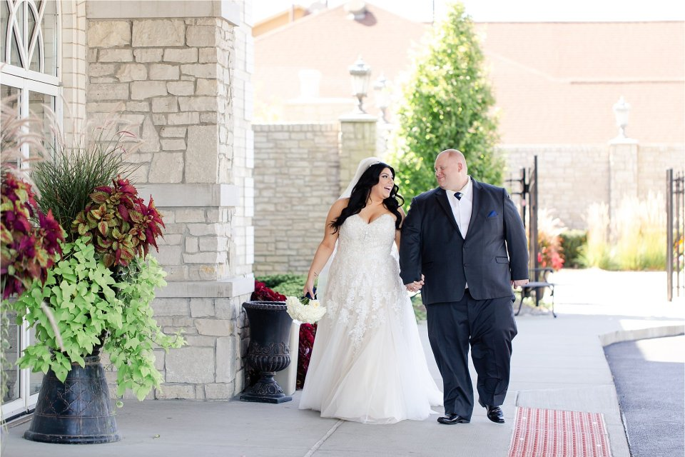 Bride and groom walking at Tuscany Falls in Tinley Park by Karen Shoufler Photography