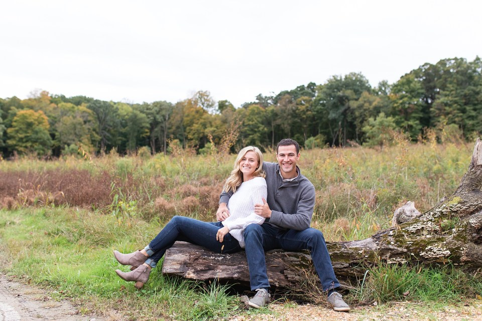 Stylish Couple on fallen log in the fall at Morton Arboretum Engagement Photography by Karen Shoufler
