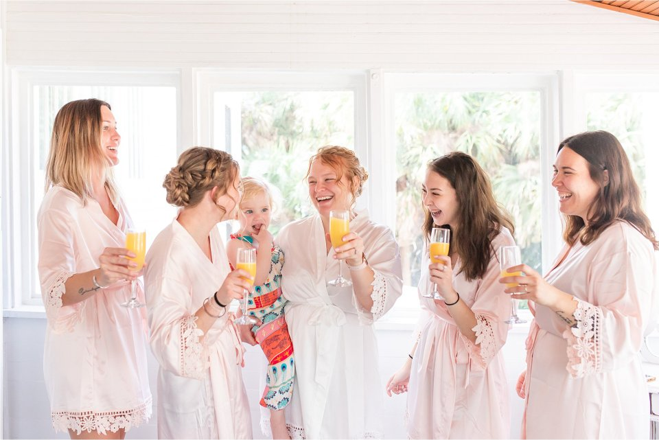 Bride and bridesmaids getting ready at Heitman House in Fort Myers, Florida wedding
