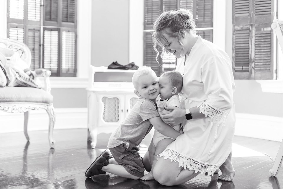Bride and babies getting ready at Heitman House in Ft Myers, Florida wedding
