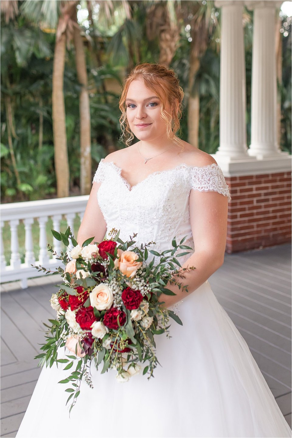 Bride outside on porch at Heitman House in downtown Ft Myers, Florida wedding