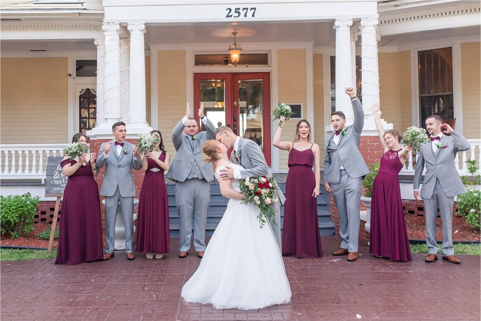 Spring wedding party outside at Heitman House in downtown Ft Myers, Florida wedding venue