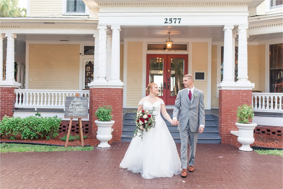 Bride and groom at spring wedding outside at Heitman House in downtown Ft Myers, Florida wedding venue