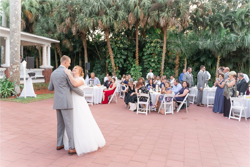 Bride and groom first dance at spring wedding outside at Heitman House in downtown Ft Myers, Florida wedding venue