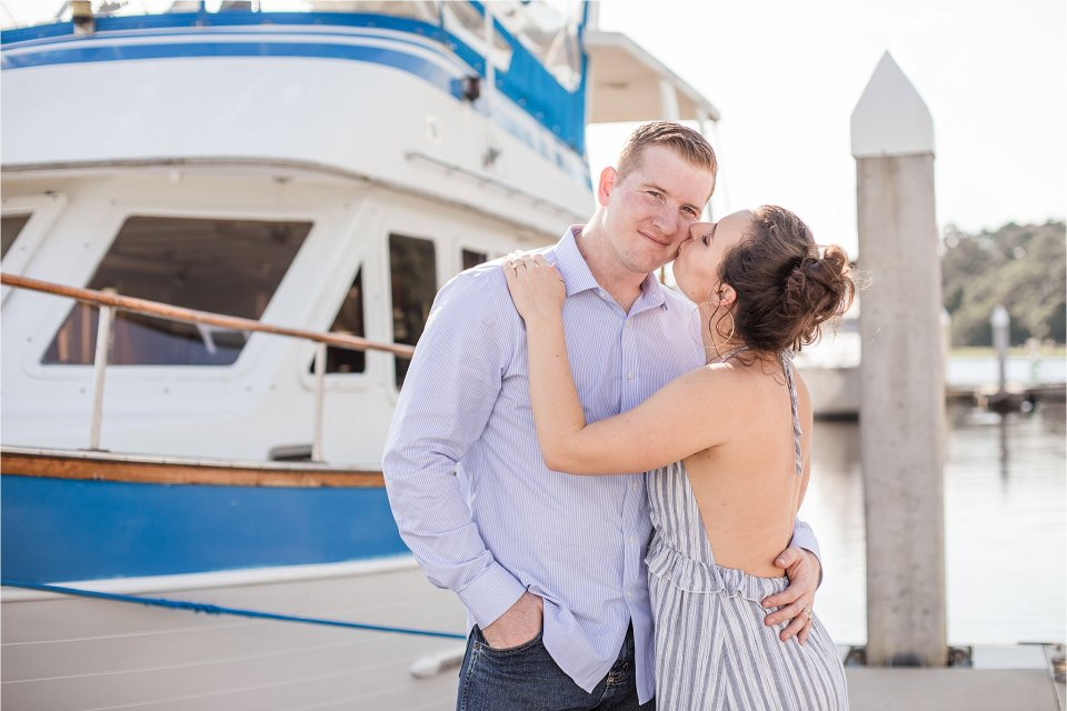 Georgia marina engagement photography on dock with boats and water