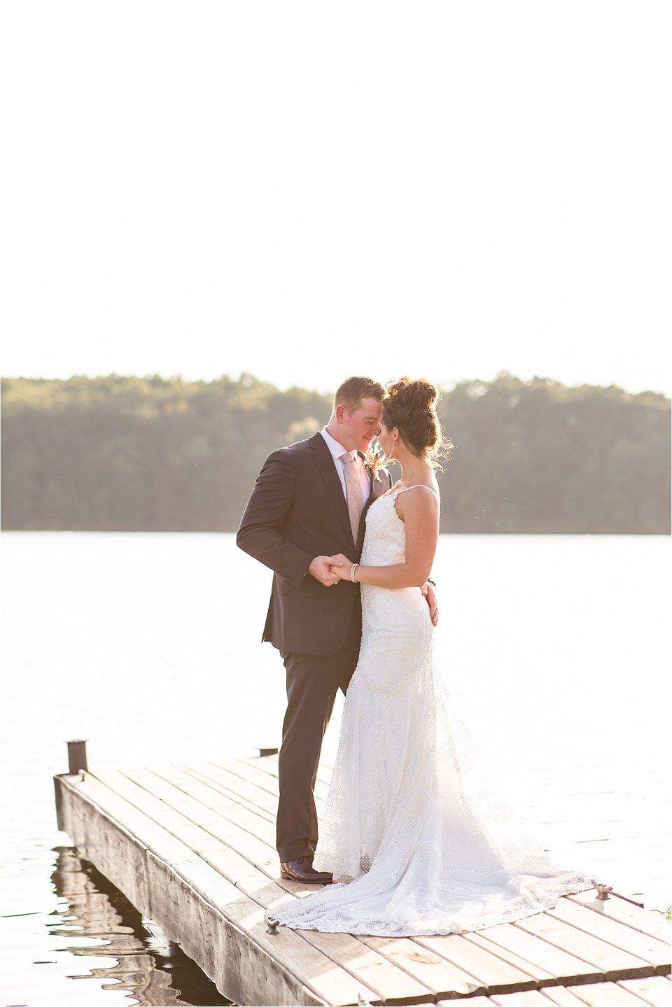 bride and groom on dock at Lake of Egypt wedding