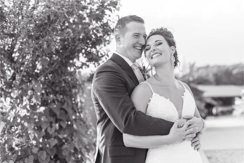 bride and groom laughing black and white at outdoor wedding in Southern Illinois