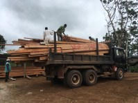 Last load of wood delivered, top layer of wood was unloaded manually