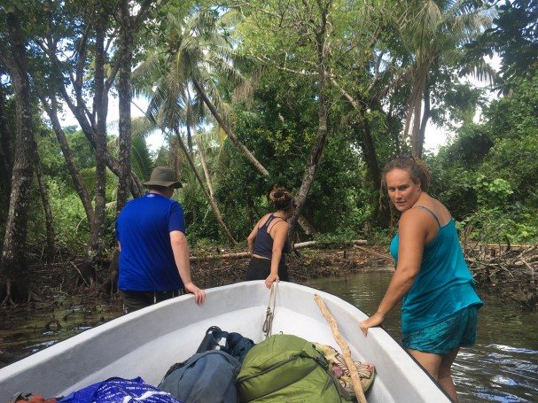 bringing our boat in through the mangrove