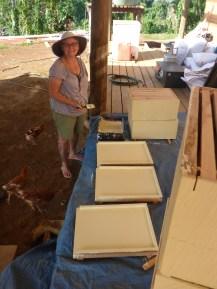 Karen painting the bottom boards
