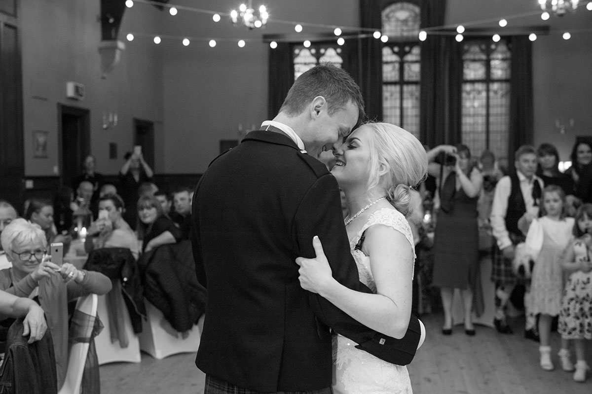 Wedding portfolio - monochrome image of bride and groom with their foreheads touching during their wedding first dance
