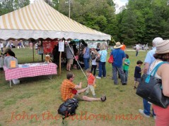 Balloon line at Clydefest in the striped tent.