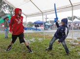 Balloon sword fight in the tent.