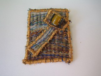 Dusty road brooch