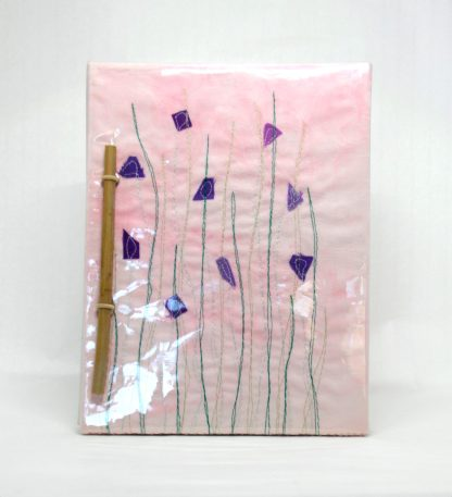Machine Embroidered Notebook with plastic cover to ensure longevity.