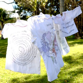 Men & Children -They sought refuge – Hand stitching on shirts by Tamara Russell – Karhina.com