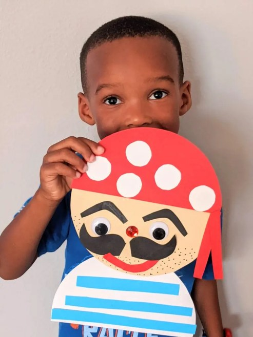 boy holding a picture of pirate craft