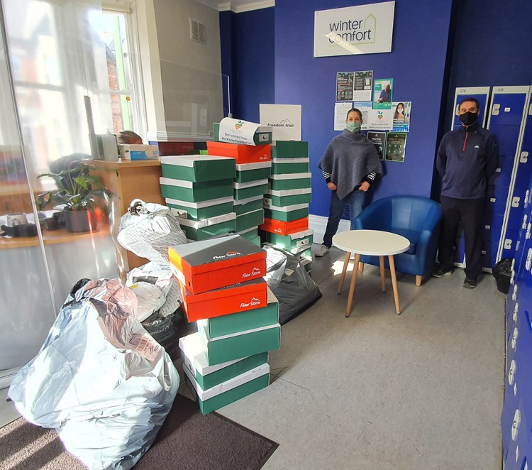 Delivering the items of warm clothing and footwear to Wintercomfort