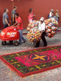 Street vendors take great care to avoid stepping on the alfombras. Antigua, Guatemala -- April Beresford
