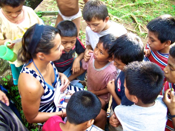 Children at Casa Guatemala gather around Karina, Rio Dulce, Guatemala -- April Beresford