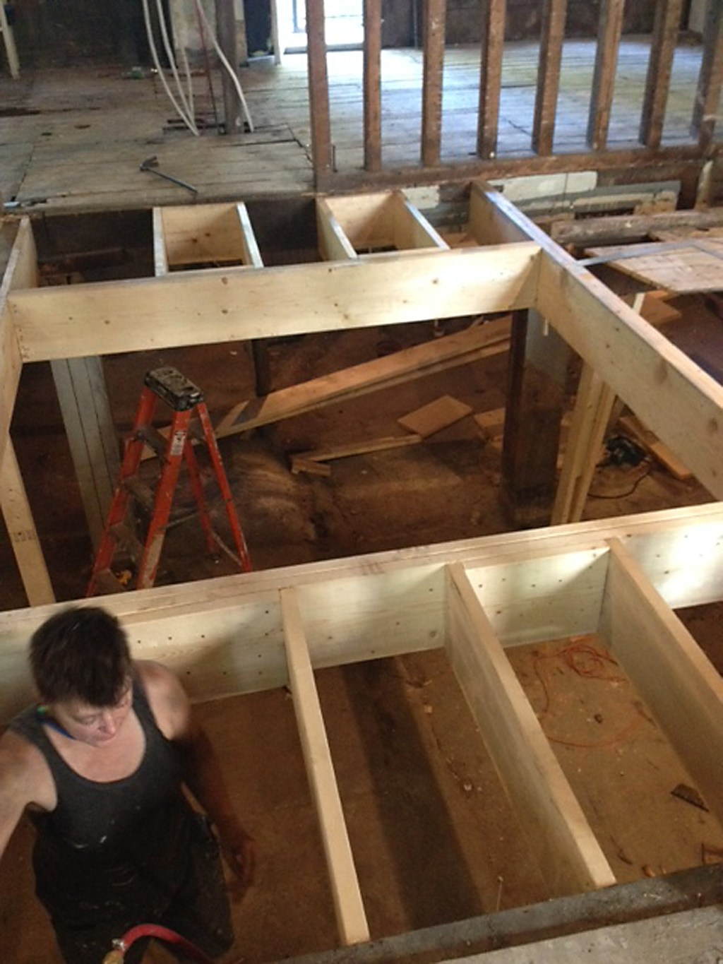 Framing the new stairwell opening.