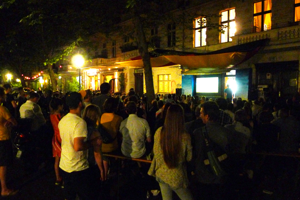 Watching football, soccer outdoors on a big screen TV