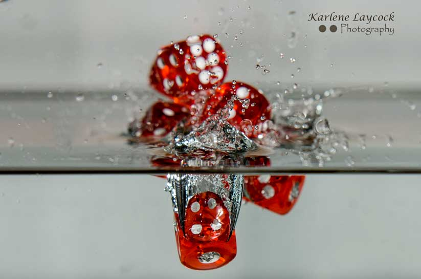 Red Dice falling into water inverted Series 1