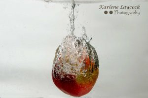 Red Apple encased in water bubble on grey 3