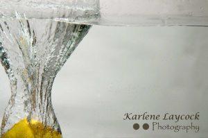 Lemon encased in water vase on grey 3