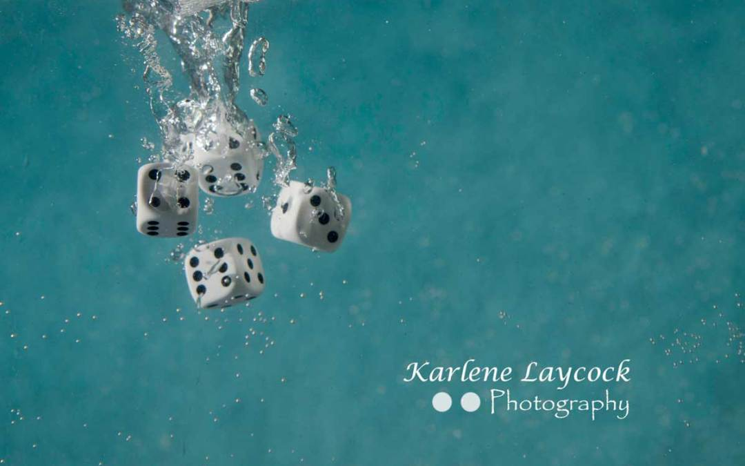White Dice Falling into Water 3