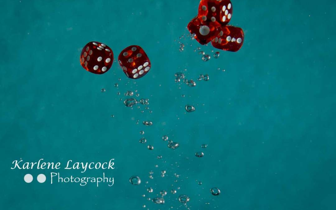 Red Dice Bubbling in Water 5