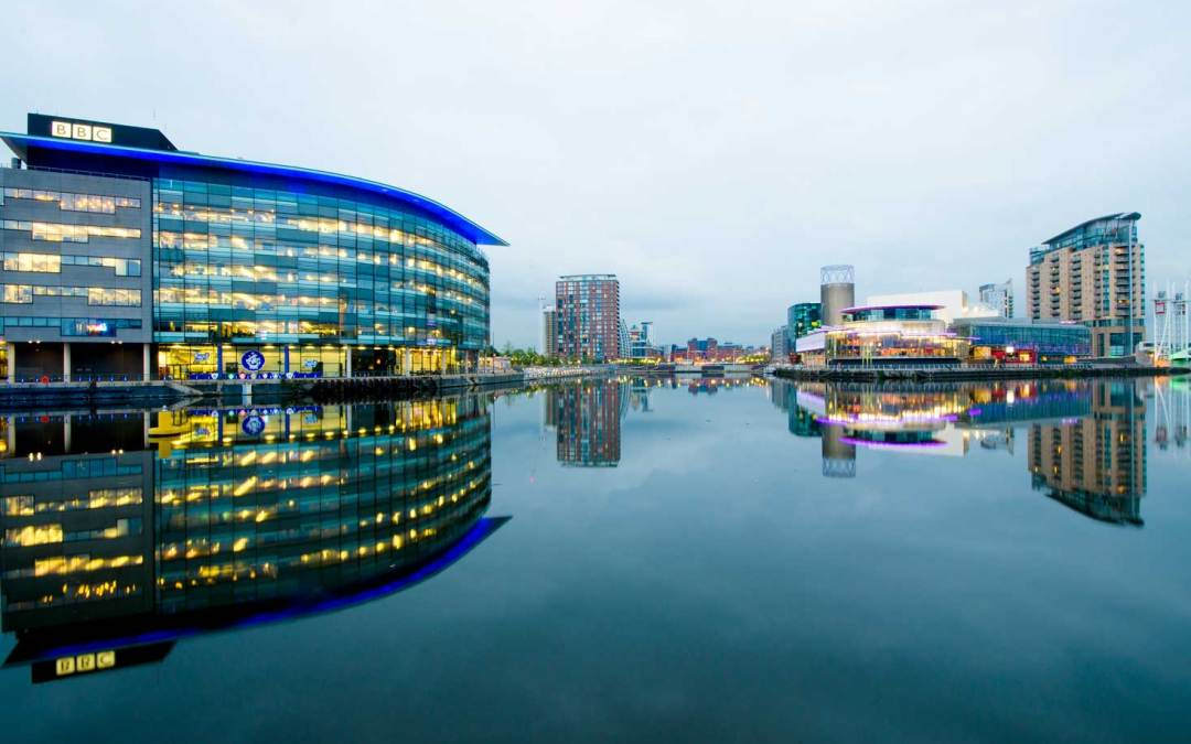 Photograph of Salford Quays Featuring the BBC Building Reflected onto the Quays