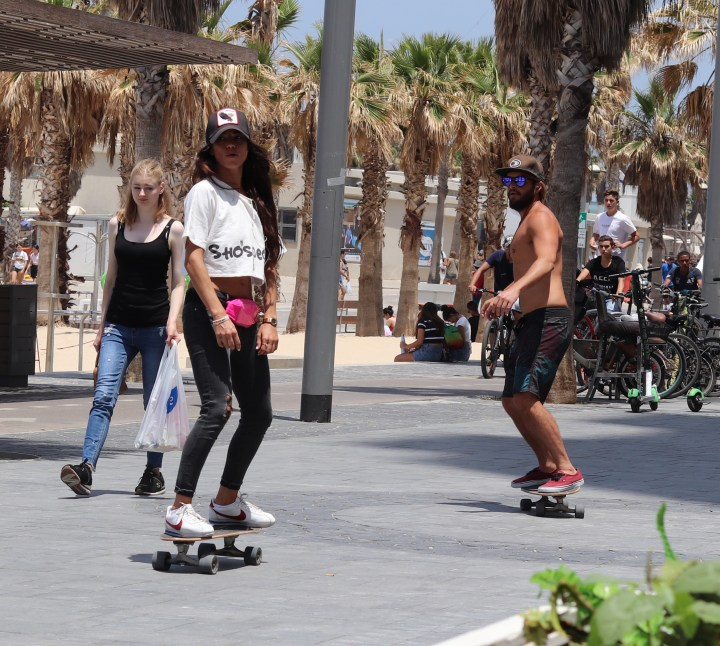 Skateboarders on the Promenade of Gordon Beach, Tel Aviv