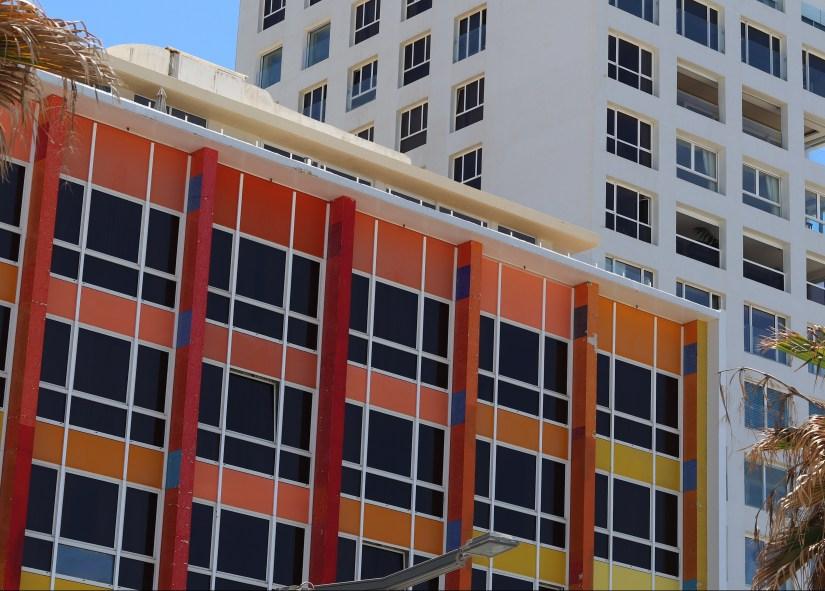 The rainbow coloured Dan Hotel, Frishman beach