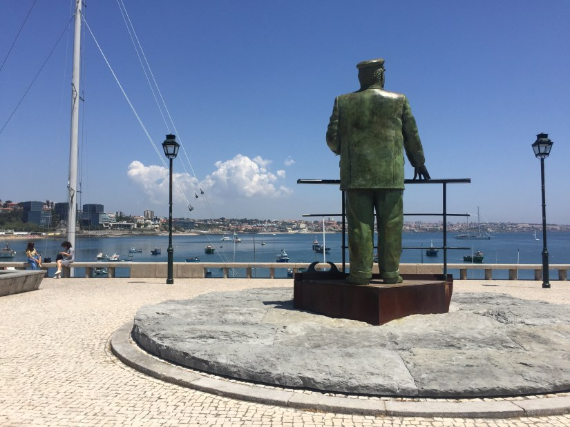 A bronze statue looking out over the harbour of Cascais