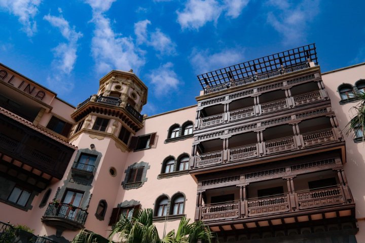 A view of the Hotel Santa Catalina from the front of the hotel. The front of the hotel is decorated with carved wooden balconies.