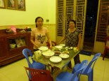 Venny's mom and sister Muoyheak, with the delicious dinner they made! Green beans, ginger fish, pickled cabbage... so good.