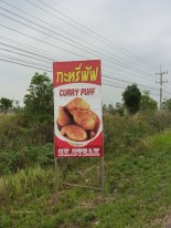 "Often, road signs are the highlights of my rides. This was one of about 100 signs that said ""STEAK."" Curry puff sounded good, but I didn't stop."