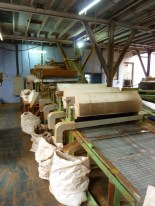 Then, the withered, fermented leaves are dried in an over for about half an hour, and separated again by size in these machines. Each of these sacks has a different size of tea leaf, from tiny dust, up to the full-sized orange pekoe.