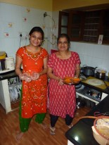 Keerthi and her mom in the kitchen, making magic