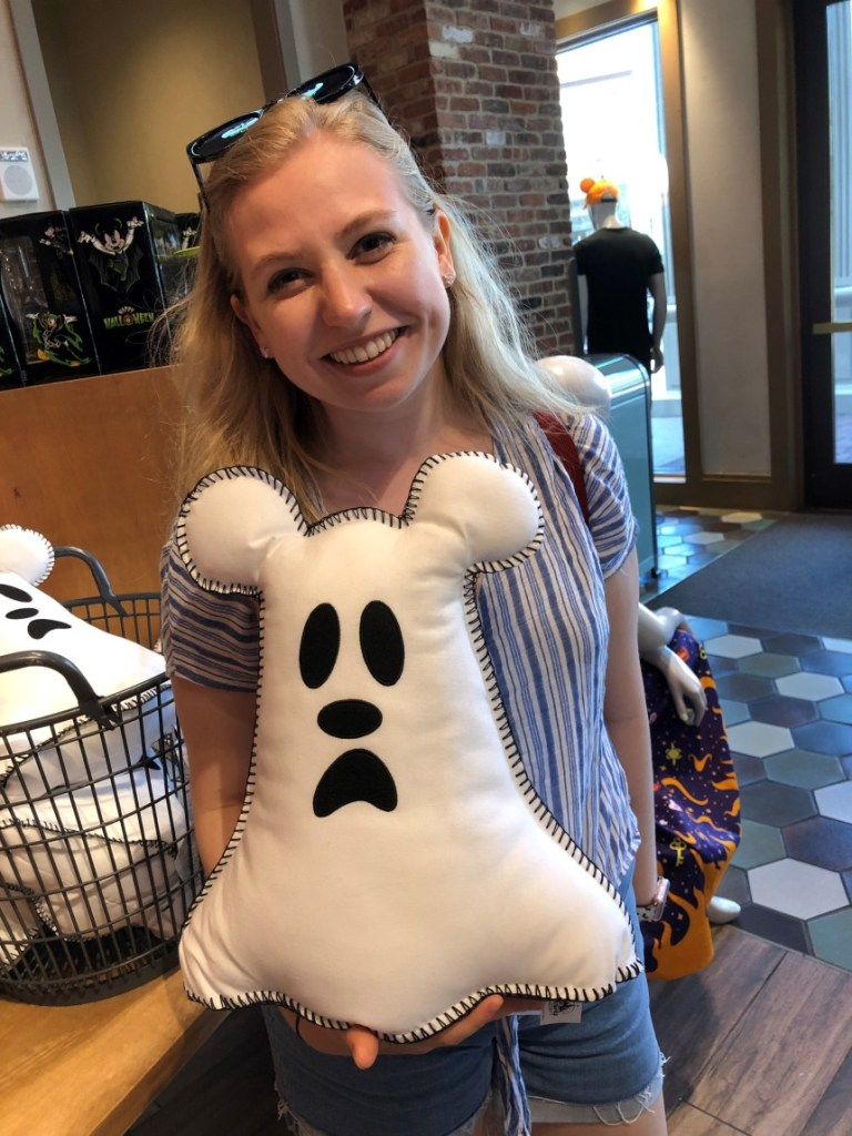 Kelly holding a Mickey Mouse ghost pillow