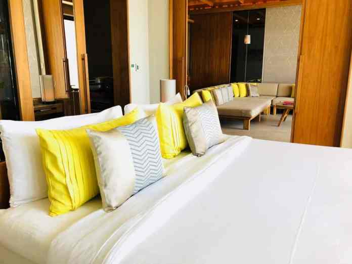 luxury hotel bed yellow pillow