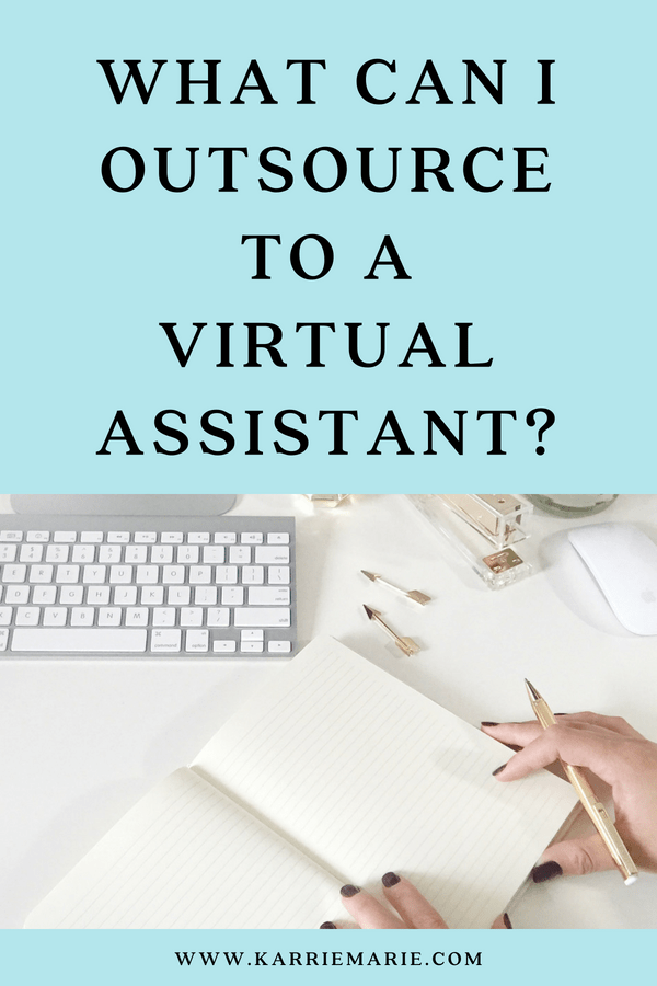computer keyboard outsource hand with a pencil and planner virtual assistant freelancer