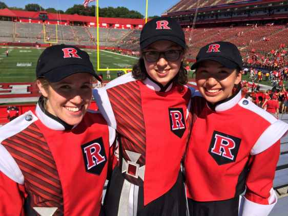 Three_Marching_Scarlet_Knights_perform_at_a_football_game_in_High_Point_Solutions_Stadium